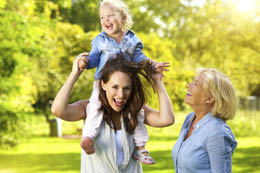 Happy mother with child and grandmother